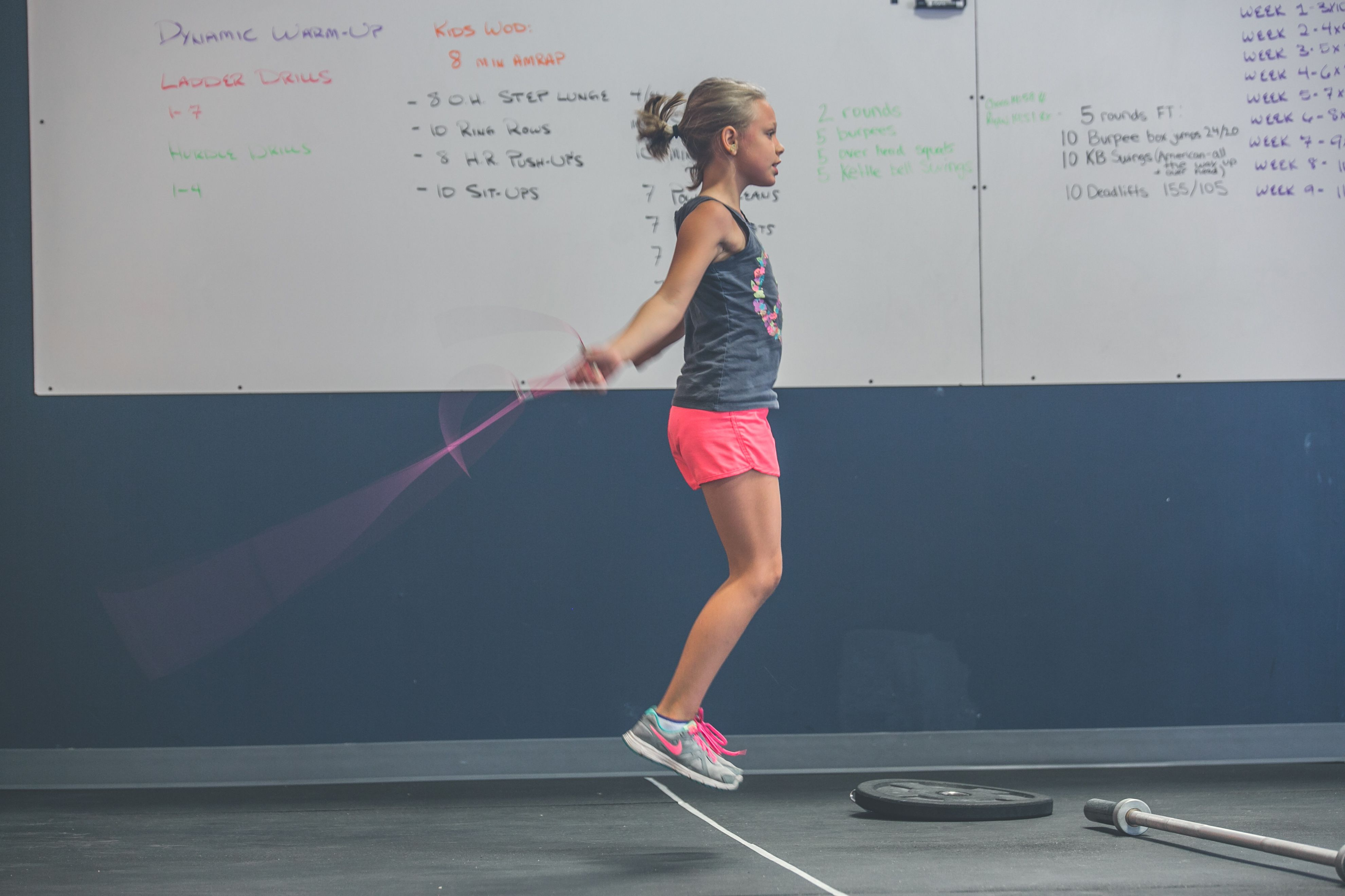 Girl jumping rope in gym